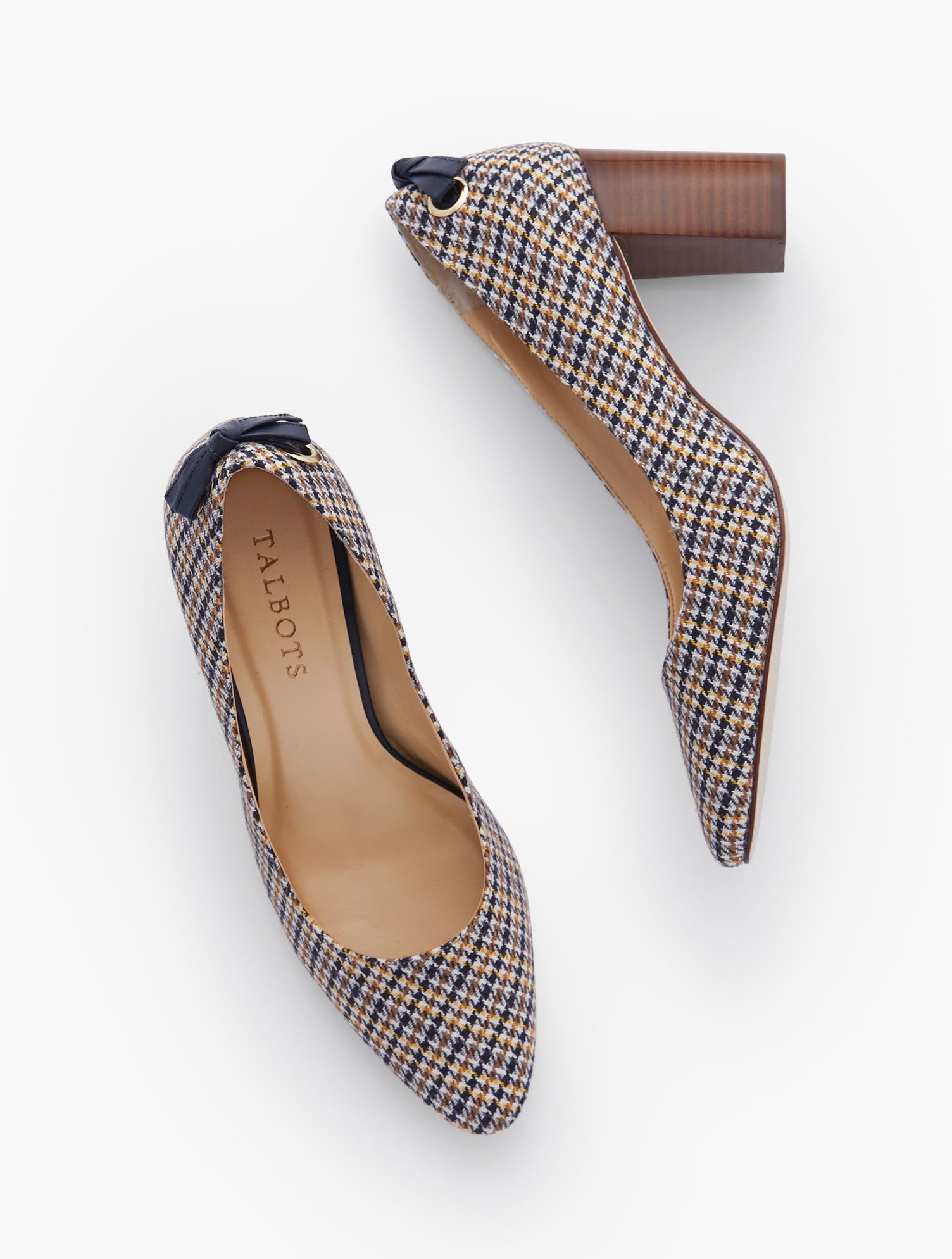 Our classic Kelsey Block Heel Pumps. Tie detail at back adds an extra dose of fashion interest. In elegant houndstooth. Features 3MM Memory foam footbed 3 inches heel Back tie detail Almond toe Imported Material: 34% Acrylic, 33% Polyolefin, 19% Polyester, 10% Wool, 4% Other Fibers Kelsey Tie Detail Block Heel Pumps - Houndstooth - Ivory - 11M Talbots