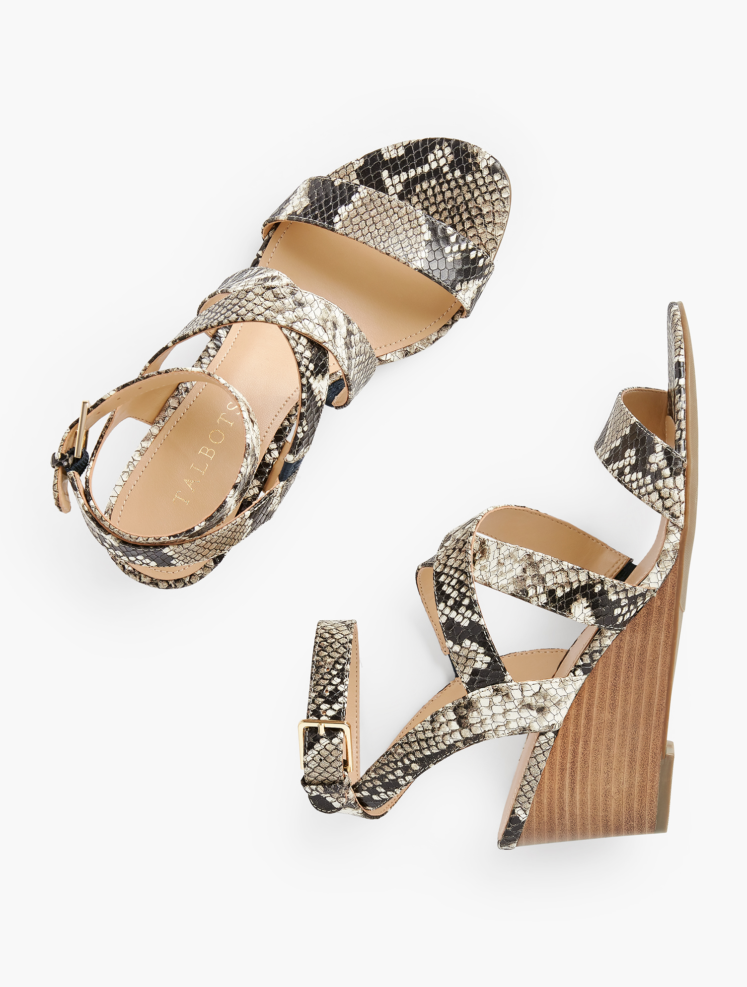 Strappy wedges in on-trend embossed leather. These sandals will elevate any outfit. Features Almond ToeNatural Stack Heel - Rubber Sole3MM Memory FoamImported Material: 100% Leather Royce Strappy Wedges - Embossed - Ivory/Black - 11M Talbots