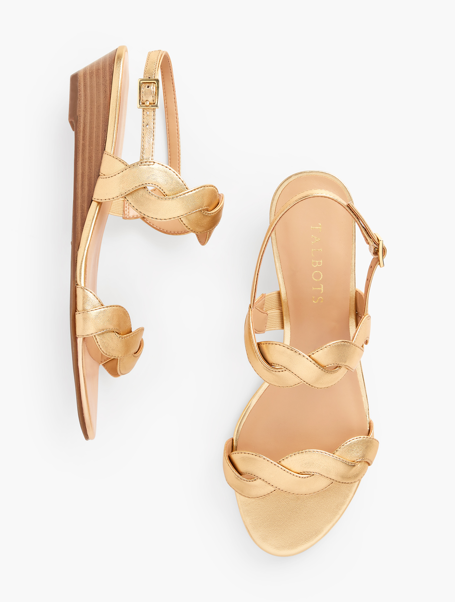 Shimmery metallic leather. Super comfortable mini wedge. Stylish twist straps. The Capri will be your new go-to sandal. Features Heel Height: 1 3/4 inches Round Toe Mini Wedge 3MM Memory Foam Imported Material: 100% Leather Capri Twist Mini Wedge Sandals - Metallic Leather - Gold - 9-1/2M Talbots