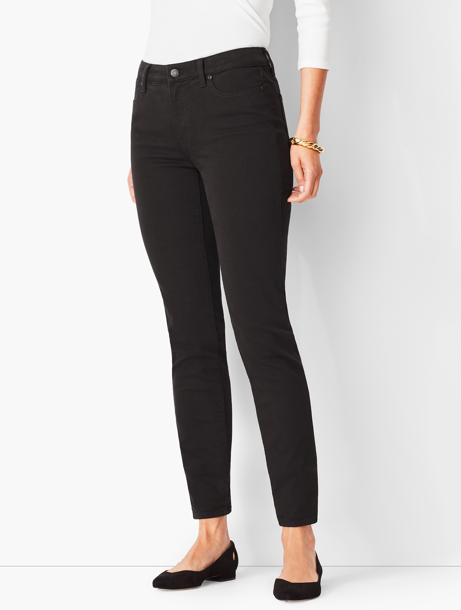 Our classic black denim is now completely fade-resistant, retaining its true color, wash after wash. Designed to lift, smooth and sculpt, these never-fade black jeans are a polished alternative to your everyday pair. Crafted from stretch denim, they\\\'re finished with our invisible slimming panel for the perfect, most flattering fit. Pair with a solid, stripe or statement tee for a casual look with style in no time. If you have an hourglass figure, check out our Slim Ankle Jeans - Curvy Fit- Black