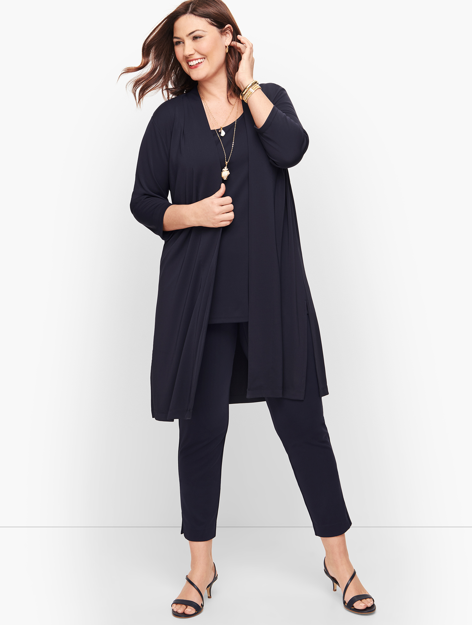 This knee-length open cardigan in our classic knit jersey fabric is a style staple. Features Sleeve length: Three-QuarterHits: Below hipNeckline: No CloseUnlinedImported Fit: Plus: 40 inches; Plus Petite: 38 inches Material: 95% Polyester; 5% Spandex Care: Machine Wash; Reshape, Lay Flat To Dry Knit Jersey Open Cardigan Sweater - Blue - 3X Talbots