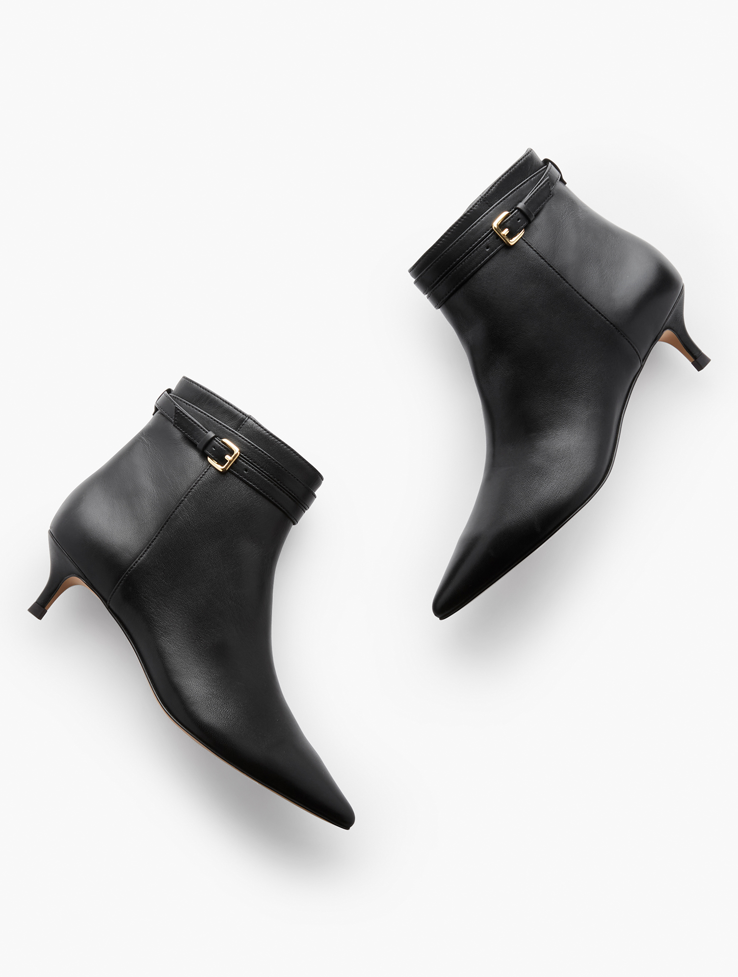 The Iona. Nappa leather elevates these classic kitten-heel booties. Dress them up or down. Features Kitten heel1 3/4 inches heelPointed Toe3MM Memory Foam FootbedImported Material: 100% Leather Iona Kitten Heel Booties - Nappa - Black - 11M Talbots