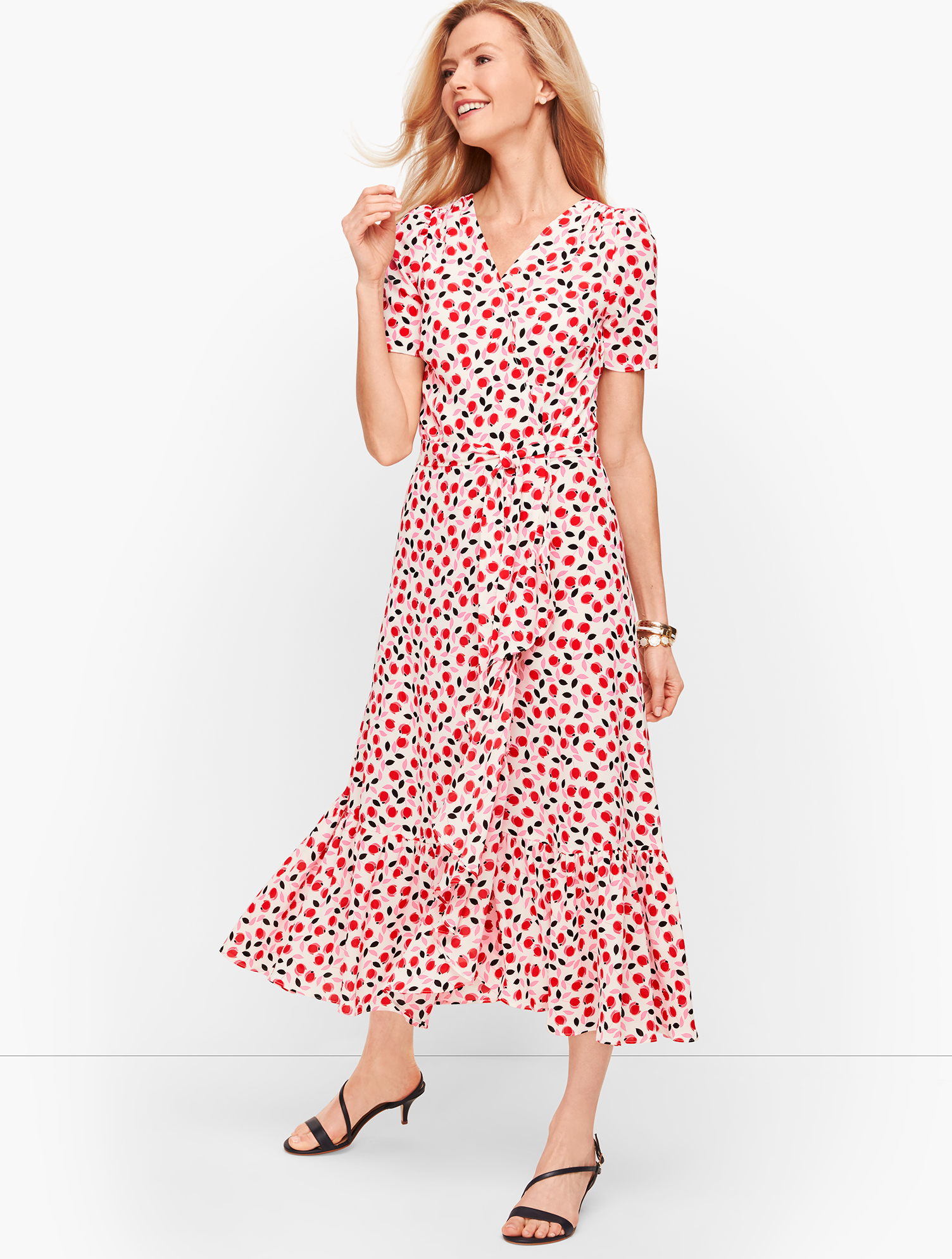 Romantic blooms. Flattering faux wrap dress styling. Cascading flounce. Go with the flow. Features Silhouette: Wrap Neckline: V-Neck Sleeve length: Short Closure: Invisible Back Zip Imported Fit: Misses: 47 inches, Petite: 43 1/2 inches, Plus: 48 inches, Plus Petite: 45 inches Material: 95% Polyester, 5% Spandex Care: Machine Wash; Tumble Dry Low Cascade Wrap Dress - Floral - Ivory - 16 Talbots