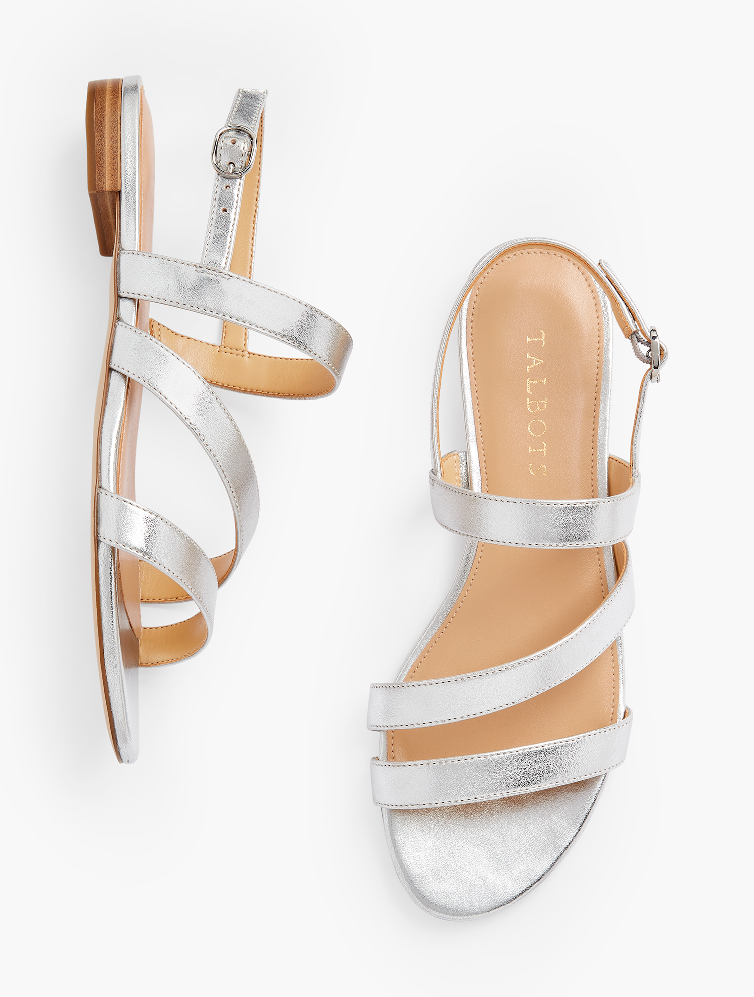 Easy elegance. Our Keri multi-strap sandals were made to be worn dressy or casual. Features 1/2 inches heelFlexible Non Skid OutsoleShiny Nickle Hardware3Mm Memory Foam FootbedImported Material: 100% Leather Keri Multi Strap Sandals - Metallic - Silver - 11M Talbots