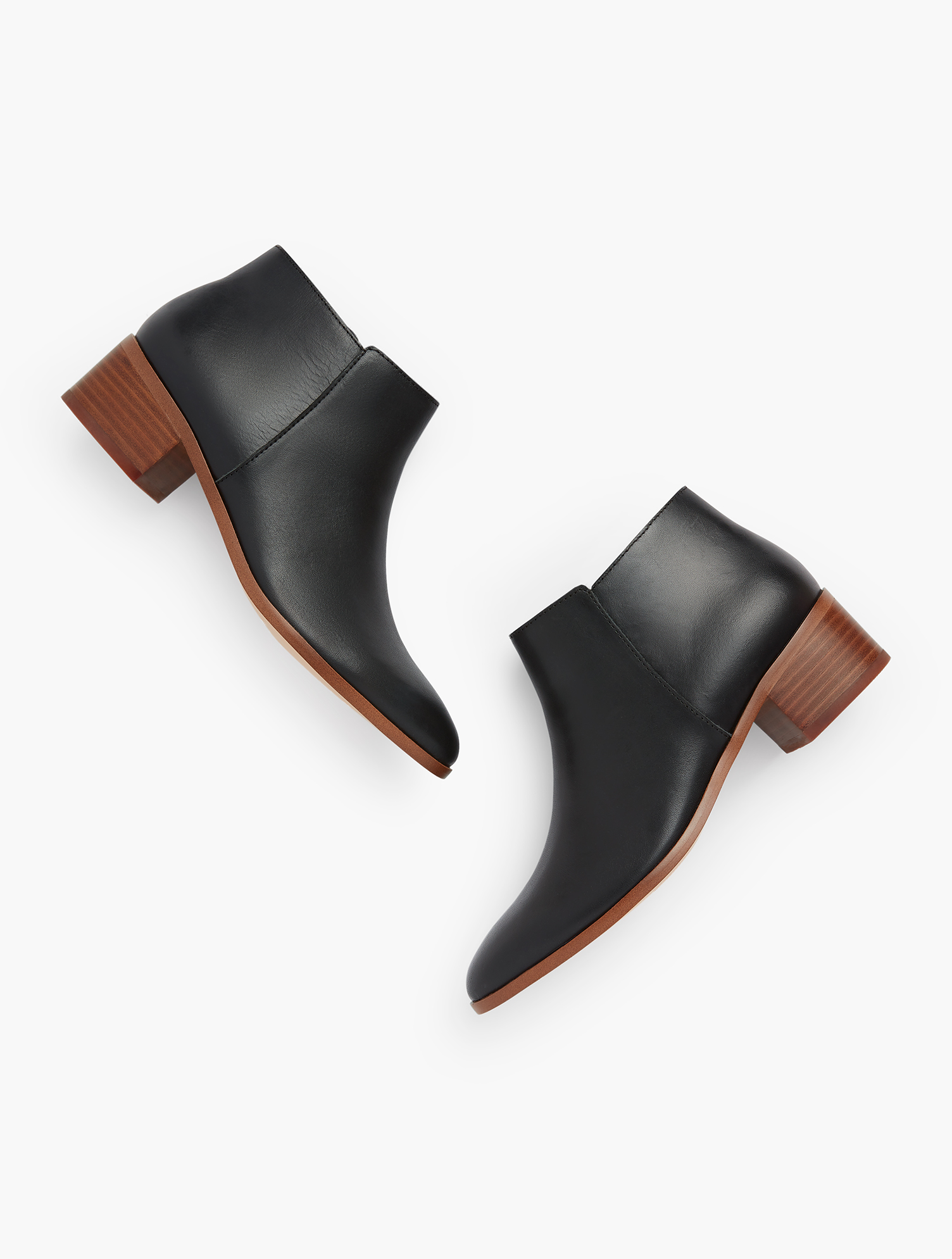 Meet your new go-to bootie. A simple silhouette, perfect for cropped pants and beyond. Finished with a block heel for a little lift. Features 1 1/2 inches heel Memory Foam FootbedBreathable LinerImported Fit: 100% Leather Via Booties - Vachetta - Black - 11M Talbots