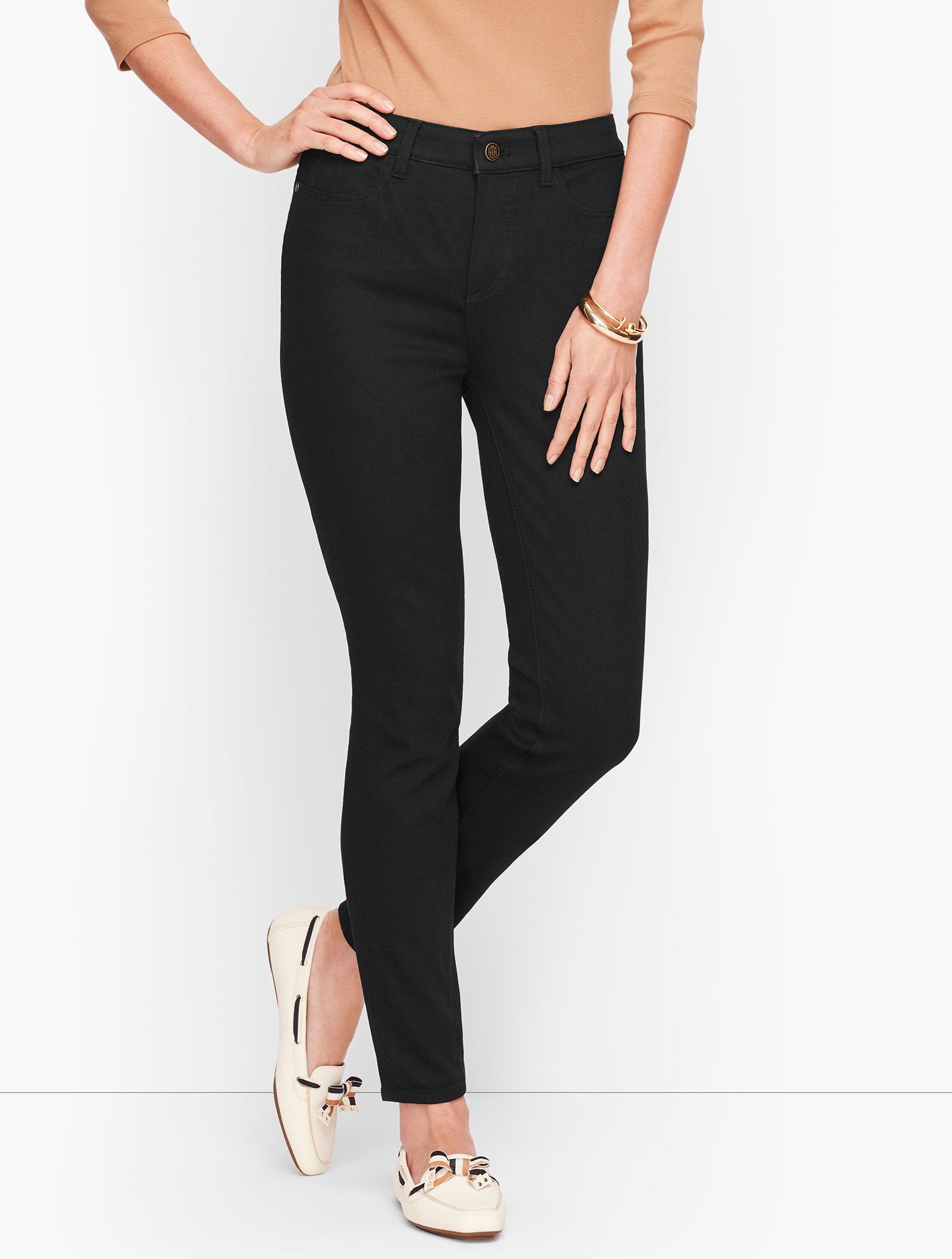 Our must-have jeggings in black, designed from the Comfort Stretch fabric that sculpts, slims and lifts, all while maintaining its great shape and snug comfort. Or, if you have an hourglass figure, check out our Denim Jegging - Curvy Fit/Black. features Skinny leg High waist Ankle length Fly front with button closure Flawless Five-Pocket Imported Fit: Inseam: Misses 29 inches; Misses Long 31 inches; Petite 26 1/2 inches; Plus 29 inches; Plus Petite 26 1/2 inches Material: 70% Cotton, 19% Polyest