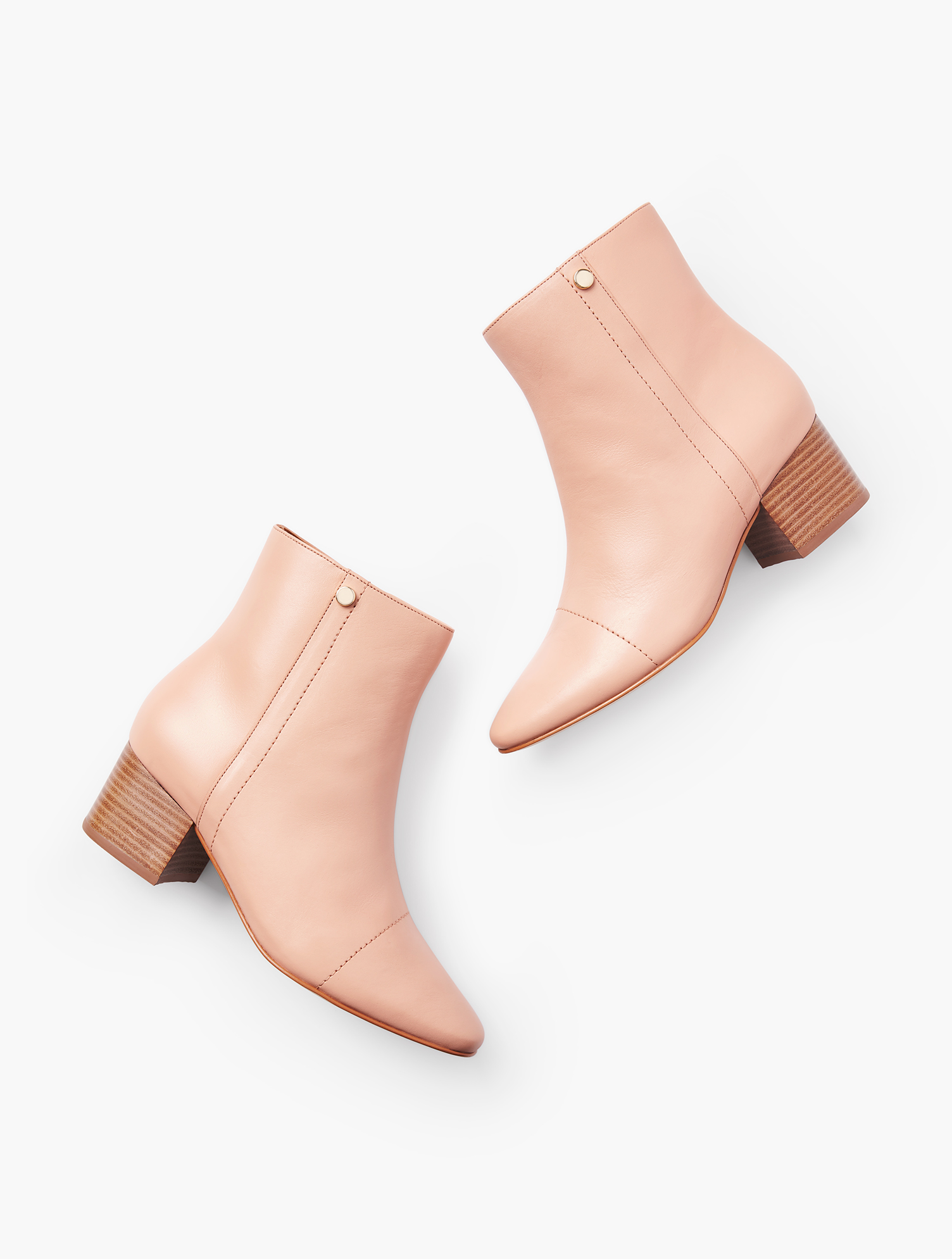 Soft nappa leather in powdery beige. This block-heel bootie is a staple in every wardrobe. Features 2 inches Heel Memory Foam Footbed Breathable Lining Imported Material: 100% Leather Harlow Booties - Powder Beige - 11M Talbots