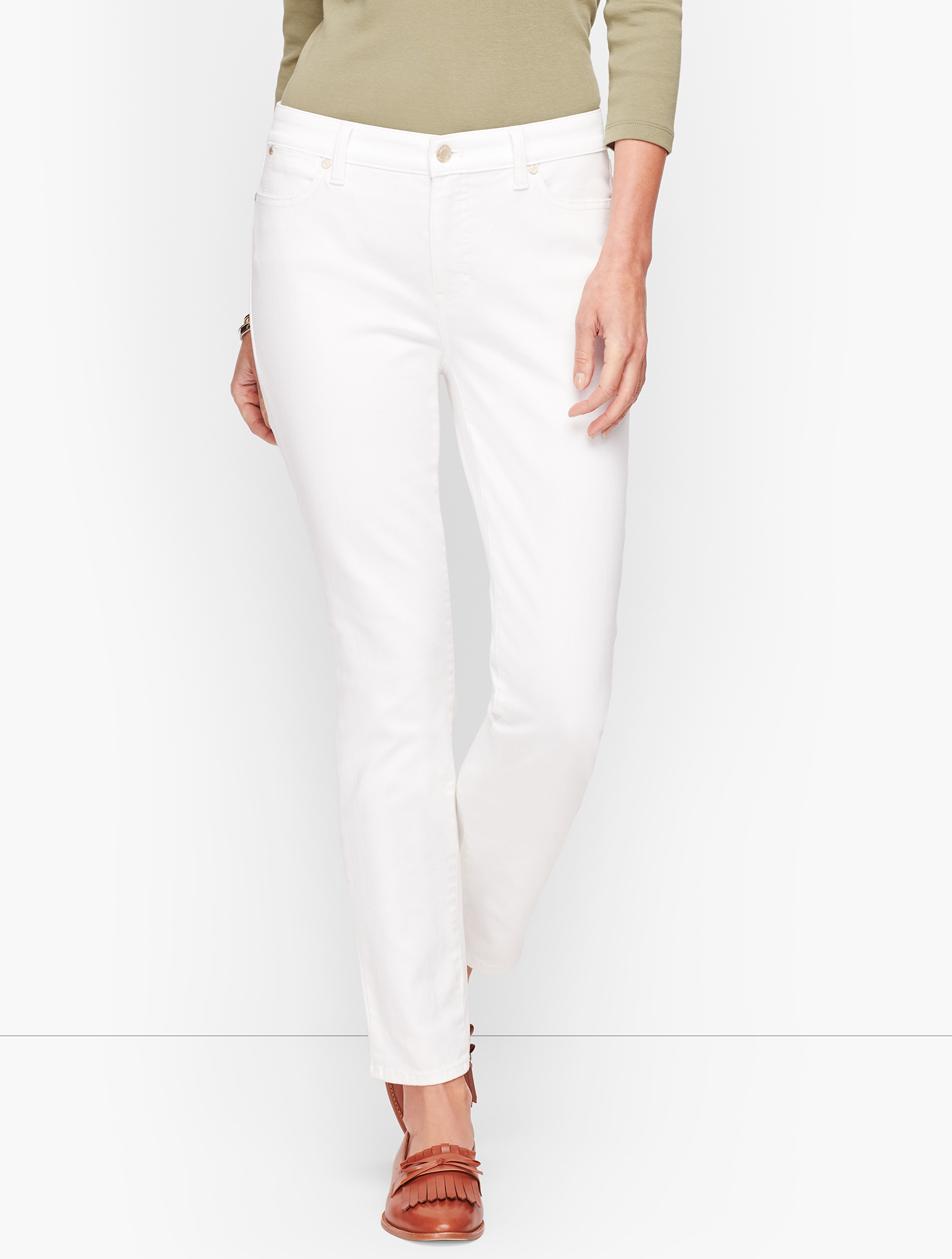 Our Flawless Five-Pocket Slim Ankle Jeans are artfully designed for maximum style. The charming ankle length and tapered silouette are flattering all around. So easy to pair with our tunics and ballet flats. If you have an hourglass figure, check out our Slim Ankle Jeans - Curvy Fit. features Slim Fit Hits: At Waist Ankle Length Closure: Front Button Pockets: Five-Pocket Invisible Slimming Panel Imported Fit: Inseam: Misses 29 inches; Misses Long: 31 inches; Petite 26 1/2; Plus Size 29 inches; P