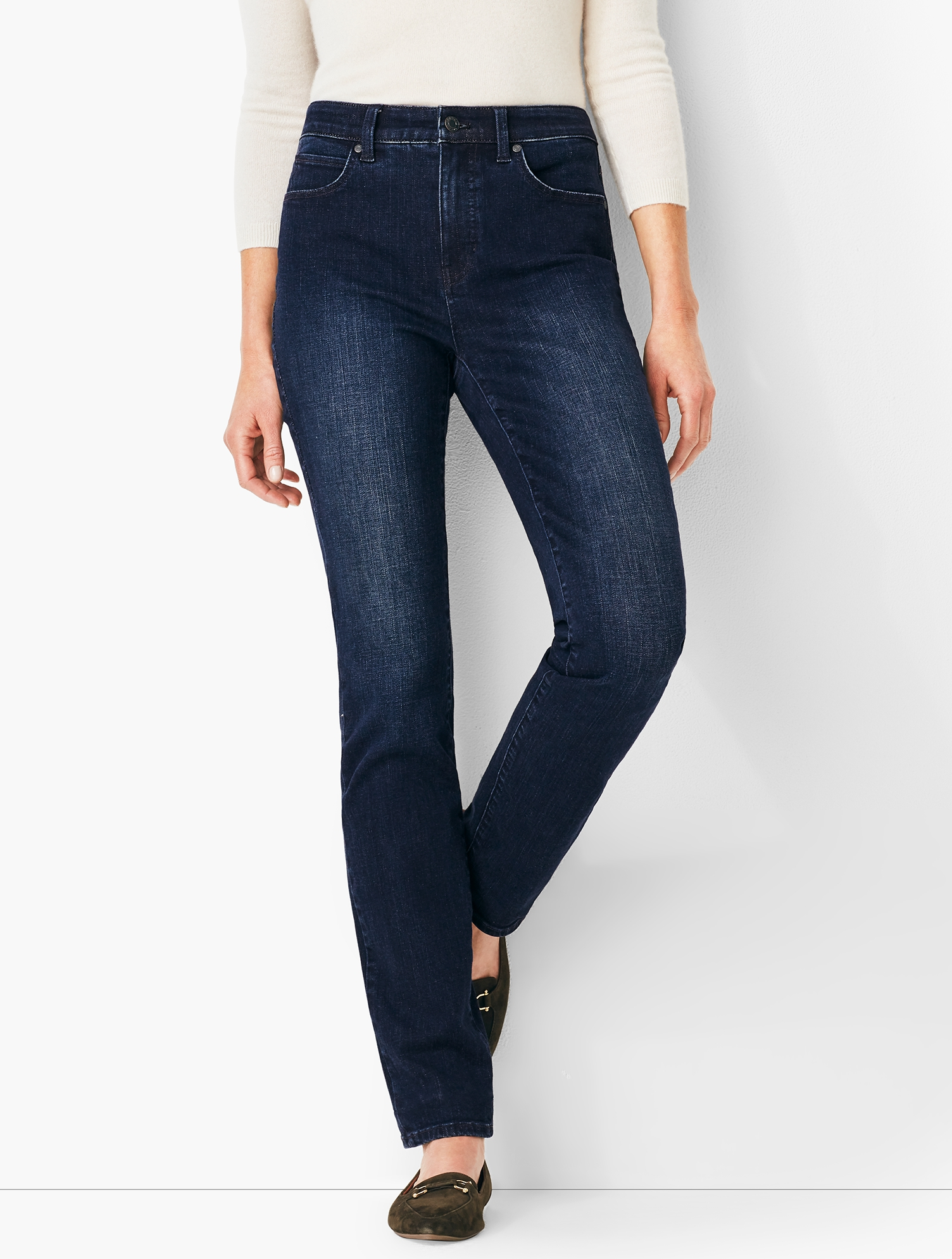 A classic silhouette with a straight fit from knee to hem. This updated wash is exactly what your closet\\\'s been missing! The super stretch denim, flattering high rise and invisible slimming panel work to hold you in, smooth you out and contour curves for a flawless fit. If you have an hourglass figure, check out our High-Rise Straight-Leg Jeans - Marco Wash/Curvy Fit. features Straight Leg Hits: High Waist Full Length Closure: Fly Front With Button Imported Fit: Inseam: Misses: 31 inches; Misses