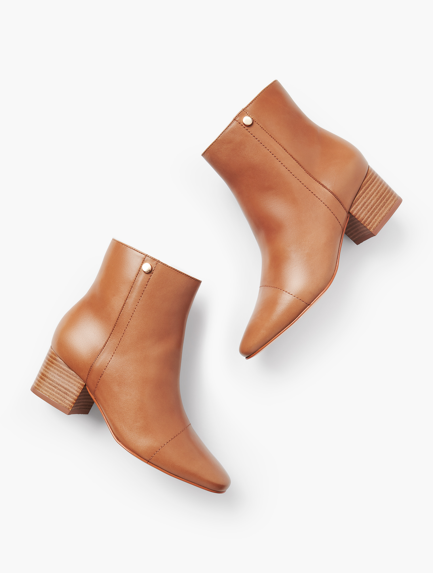 Classic block-heel booties, updated with a stylish cap toe. Features 2 inches Heel Memory Foam Footbed Breathable Lining Imported Material: 100% Leather Harlow Cap Toe Booties - Dark - 11M Talbots