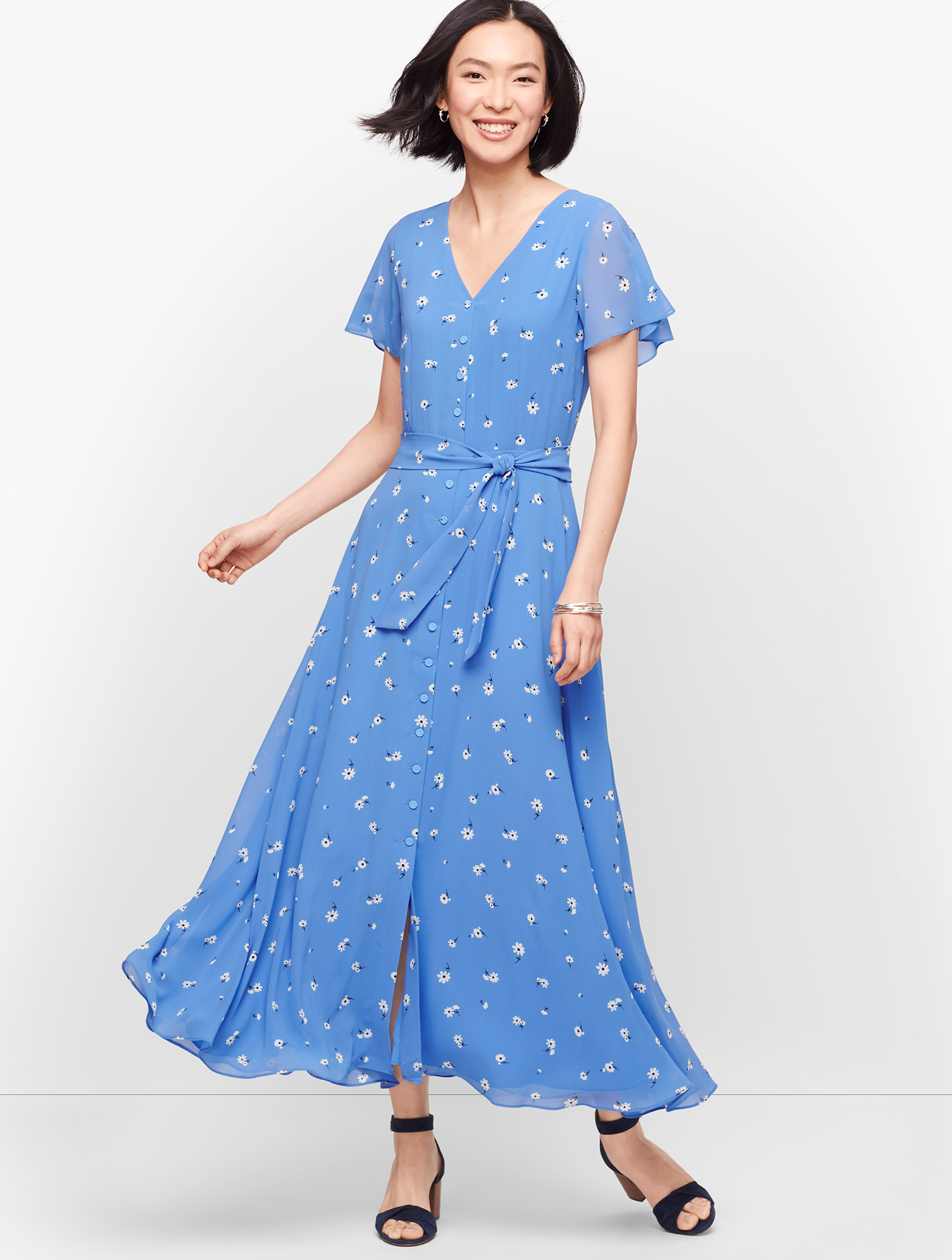 Flowy chiffon. Fashionable flounce hem. Flutter sleeves. Sash tie. This midi dress has it all. Features Silhouette: Fit & flare Neckline: V-Neck Sleeve length: Short Invisible back zip Bodice Lined Imported Fit: Misses: 50 inches; Petite: 45 1/2 inches; Plus: 52 inches; Plus Petite: 50 inches Material: 100% Polyester; Lining: 100% Polyester Care: Machine Wash Cold; Line Dry Scattered Floral Tie Front Midi Dress - Blue Wave - 16 Talbots